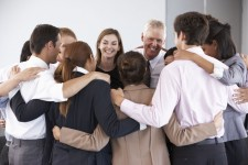 42164533 - group of businesspeople bonding in circle at company seminar
