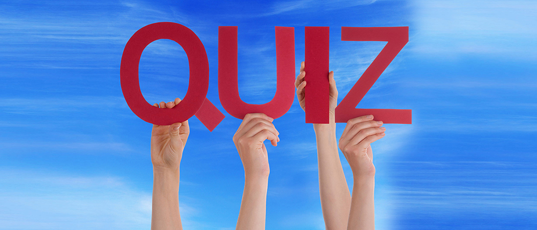 39221049 - many caucasian people and hands holding red straight letters or characters building the english word quiz on blue sky
