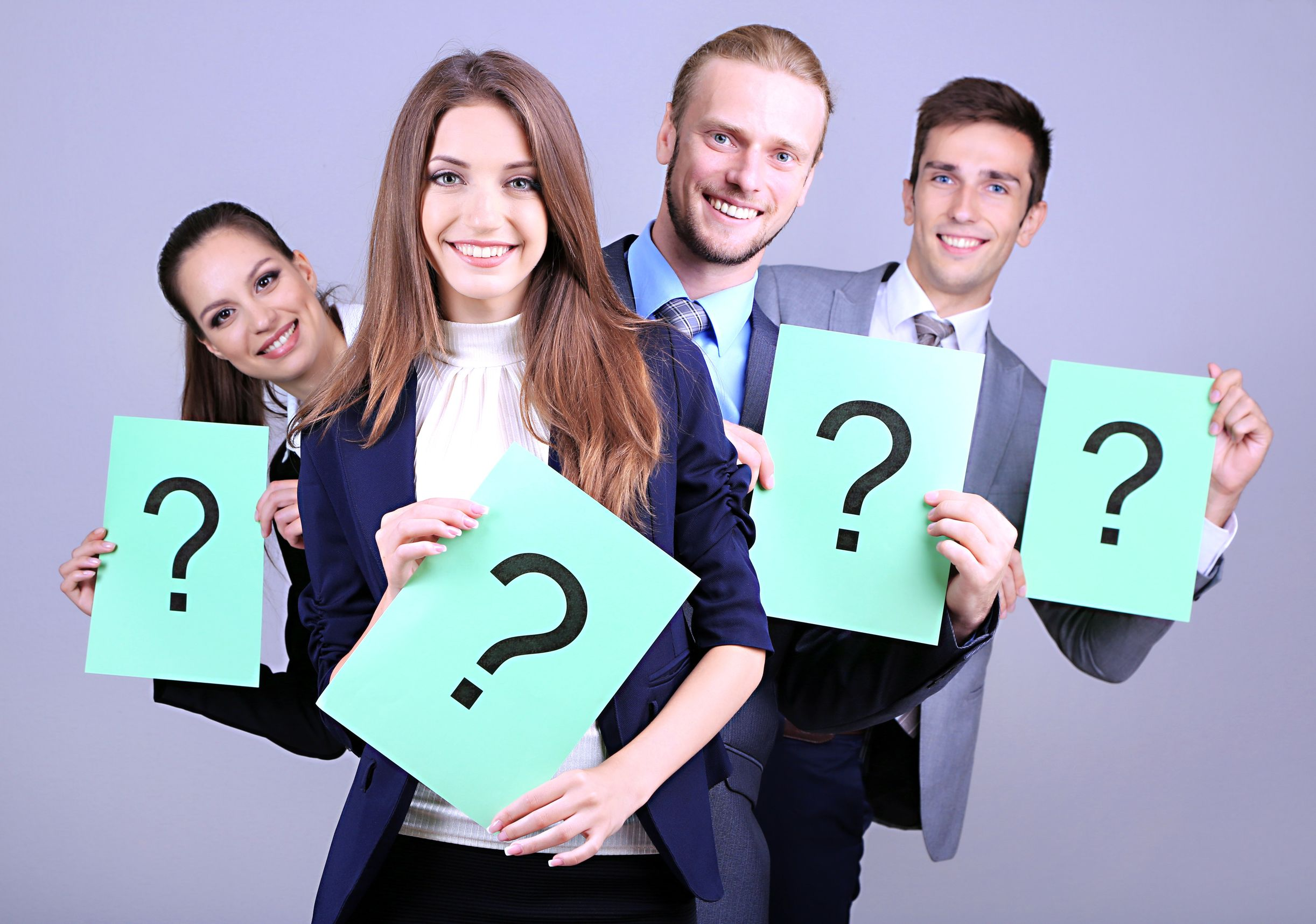 21514637 - business team standing in row with question mark on grey background