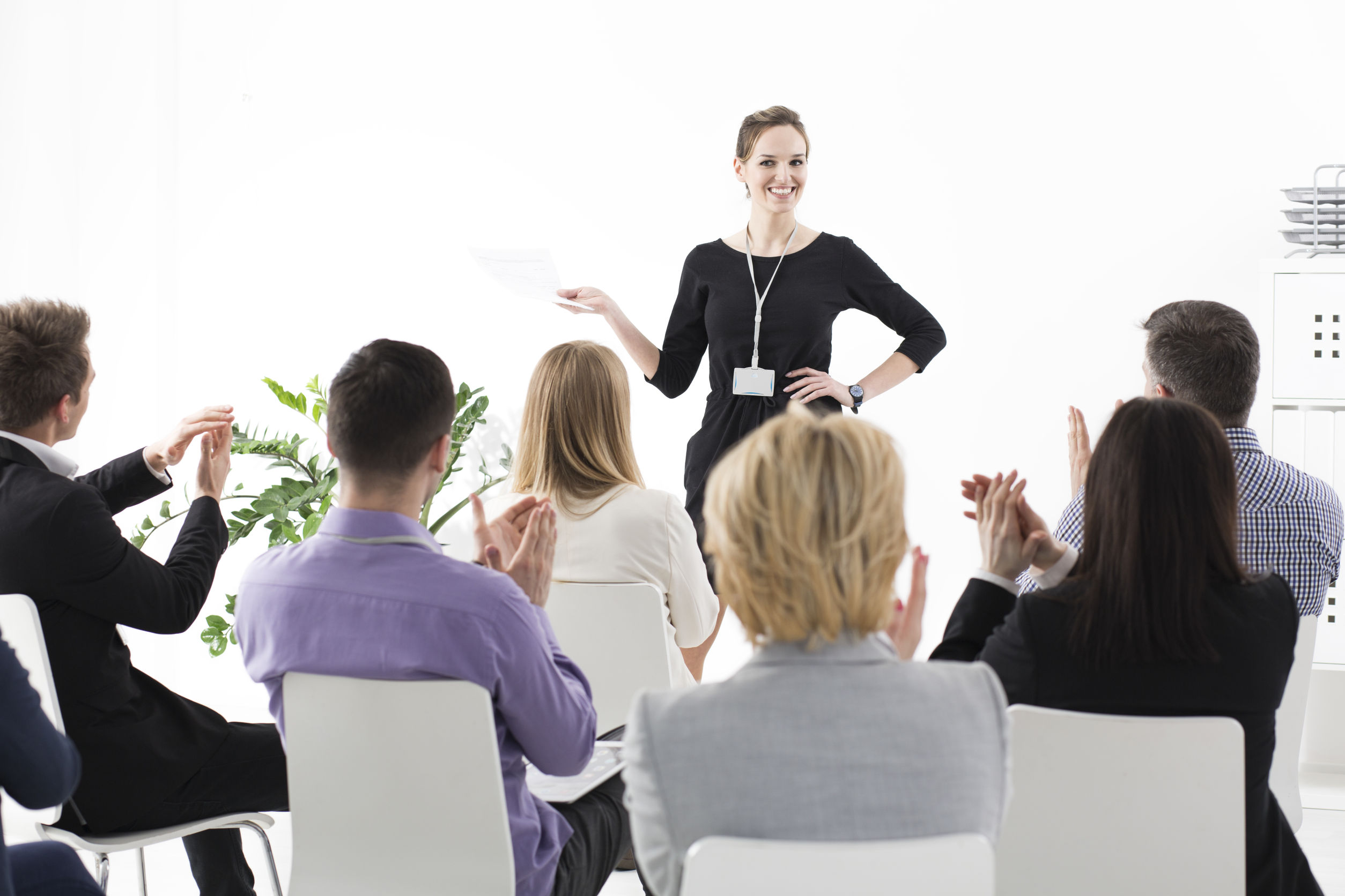 59807451 - young pretty team leader speaking in front of her colleagues during business meeting in corporation