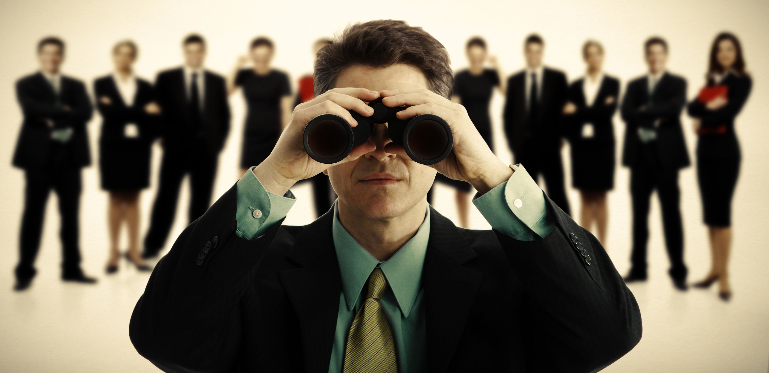 23180579 - businessman with binoculars  job search concept background